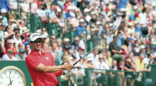 Time to get going: Adam Scott tees off at the ninth yesterday