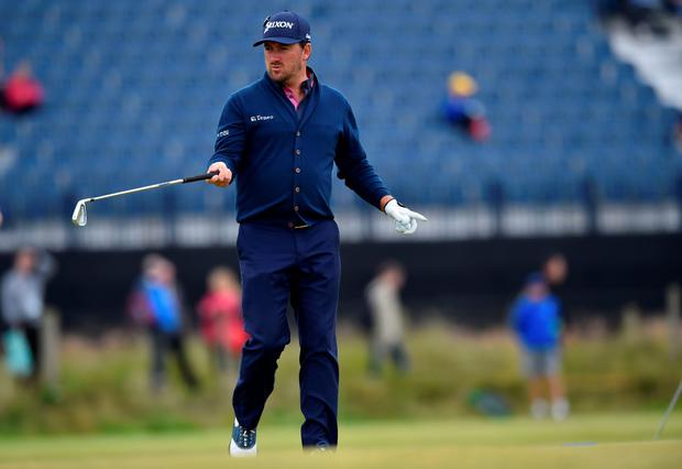 Graeme McDowell gestures on the 3rd green during a practice round on The Old Course at St Andrews