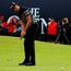 Moment of glory: Henrik Stenson makes his final putt to clinch Open success