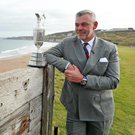 Look of love: Darren Clarke at Royal Portrush with the Claret Jug, which will be up for grabs in July