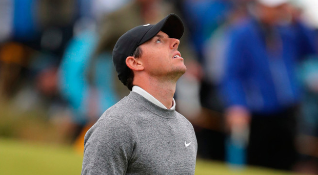 So close yet so far: Rory McIlroy looks to the heavens after crashing out of The Open when hopes of a revival on the back nine faded as he just missed the cut