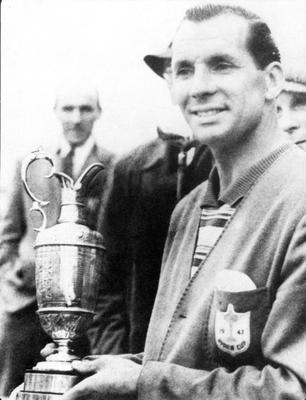 Colourful champion: Max Faulkner with the Claret Jug