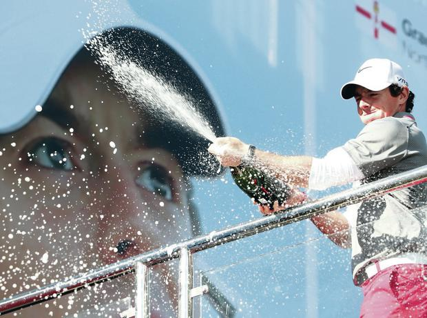 Champagne moment: Rory McIlroy celebrates his BMW PGA Championship win at Wentworth