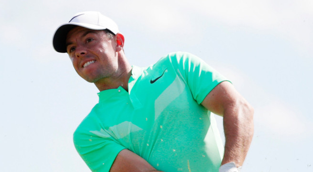 Tough going: Rory McIlroy finds himself in trouble on the eighth hole yesterday