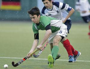 Surging run: Ireland's Johnny McKee escapes the attention of Lee Morton of Scotland yesterday