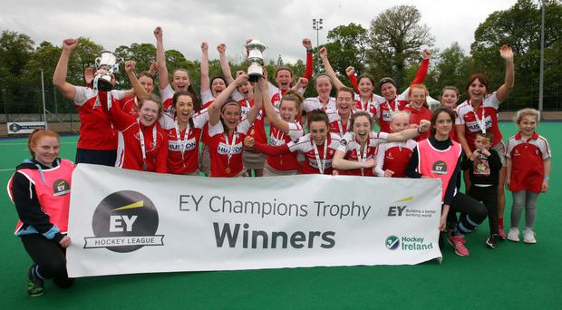 Just champion: Pegasus celebrate their EY Irish Champions Trophy success after a shoot-out at Havelock Park yesterday