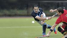 Case for the defence: Jonny Quigley makes no mistake as he clears the ball while in action for Lisnagarvey