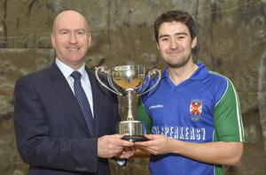 Geoff Clarke, son of the late Carson Clarke, presenting the Carson Clarke Trophy to Queen's captain, Calum Mitchell. The trophy was last played for in 1998 and was recently returned to the Branch