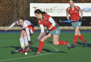 Eyes down: Knock's Sharon Wells is challenged by Cookstown's Gail Bates in Senior One clash at Shaws Bridge