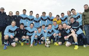 Lisnagarvey celebrate their Ulster Premier League title success after the trophy was presented to them on Saturday,
