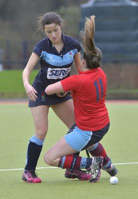 Tough clash: Laura Murray, Lisnagarvey and Orlagh O'Shea of Harlequins collide during their game at the weekend
