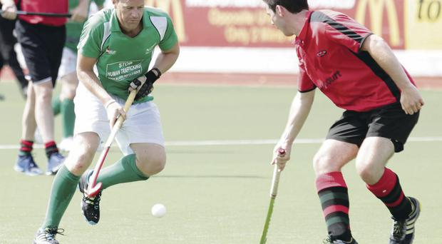 Green power: The PSNI surge forward at yesterday's hockey tournament at Stormont