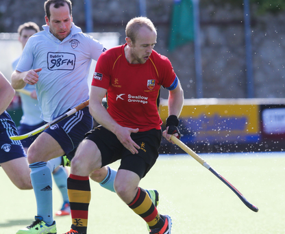 So close: Banbridge's Eugene Magee is put under pressure during the defeat to Monkstown