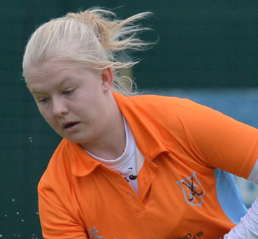 Ards striker Chloe Brown is awaiting news about her membership of the Ireland hockey squad