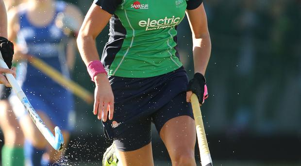 Evans above: Nikki Evans netted a hat-trick in Ireland's 4-1 win over South Africa in Valencia