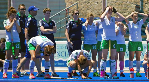 Ireland players show their despair after losing to China following a penalty shoot-out