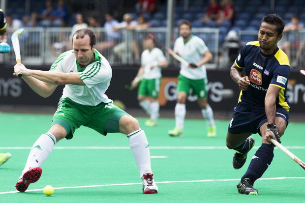 What a beauty: Peter Caruth hammers the ball into the roof of the net to set up Ireland's fifth place finish in the World League 3 series