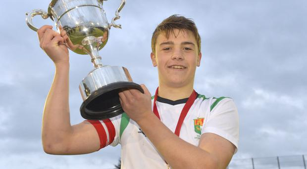 Cup win: Sullivan captain Matthew Crookshanks holds on tight to the McCullough Cup after his team won it for the first time