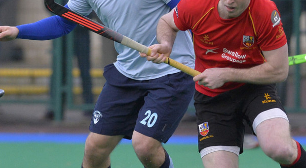 Eyes down: Banbridge's Stephen Dowds tries to keep control of the ball under the close attention of Monkstown's Richard Sykes
