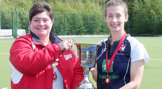 Send-off: Queen's captain Linzi Hamilton marked her final game for the club by collecting the President's Cup from Ulster Hockey President Leslie Spence