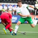 On the run: Ireland's Matthew Bell sets up another attack during the 7-1 win over Poland in Amsterdam