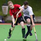 Forward thinking: North Down's Andy Boyd clashes with Ross Anderson of Civil Service in the Kirk Cup, while Irish Hockey League clubs are unhappy with umpires dispute
