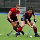 In control: Belfast Harlequins' Lizzie Colvin (right) prepares to clear her line against Cork