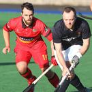 Tight tussle: Banbridge's Drew Carlisle and Lisnagarvey's Andy Williamson