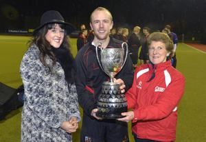 Prize guy: Banbridge captain Eugene Magee with GOC Estate Agents' Marianne McCall and UHU President Ann Rosa