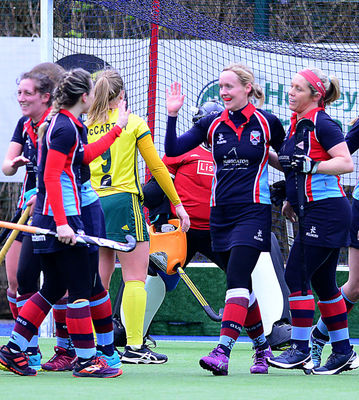On target: Claire Weir celebrates her goal for Belfast Harlequins