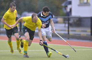 Tight contest: Railway's Kenny Carroll and Andy Forrest of Lisnagarvey battle for possession