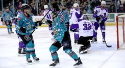 Impact player: Giants' Rickard Palmberg (right) celebrates scoring against Glasgow Clan