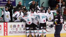 Get in: Kevin Raine is mobbed after netting the Giants' fifth goal