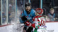 Stuck in: Liam Morgan with the Cardiff Devils' Joey Martin