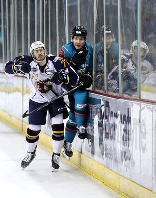 Close contact: Belfast Giants' Patrick Mullen is challenged by Owen Griffiths