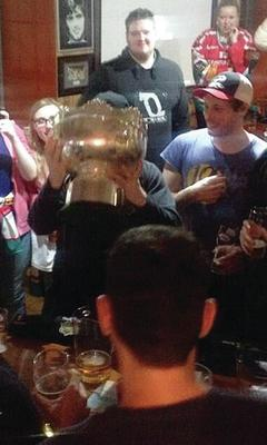 Belfast Giants players and fans pose with the trophy in a Nottingham bar a few hours after the game