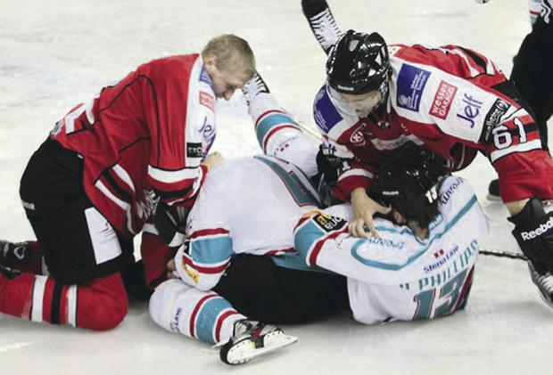 Held down: Belfast Giants players Adam Keefe and Davey Phillips are pinned to the ice by opponents