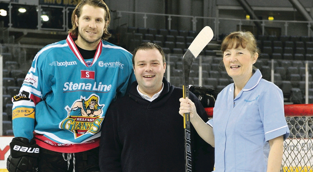 New deal: Belfast Giants forward Kevin Saurette joins Jonny Cook, MD of Peninsula Care Services and Carer Marion Burgess to launch Peninsula Care Services' sponsorship of the team