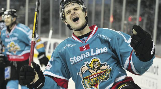 Craig Peacock of the Belfast Giants celebrates scoring his second goal against the Panthers