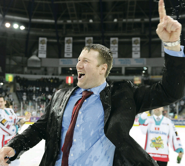 League winner: Doug Christiansen celebrates the Giants' title success in 2012 and refuses to rule out a return after Paul Adey's departure as coach