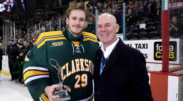 US ambassador Ralph Cox presented the Most Valuable Player Award to Clarkson Golden Knights Player Jake Kielly