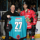 Getting shirty: Former Belfast Giants ace Paxton Schulte is presented with his famous No.27 jersey by Kendall McFaull on a recent trip back to Belfast