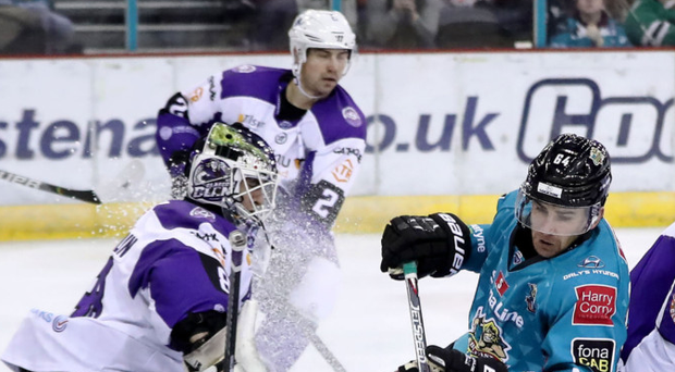 Good show: Giants' David Goodwin takes on Glasgow Clan's Jordan McLaughlin and Mathieu Roy at the SSE yesterday