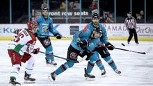 Attack mode: Belfast Giants ace Brian Ward is challenged by Sam Duggan