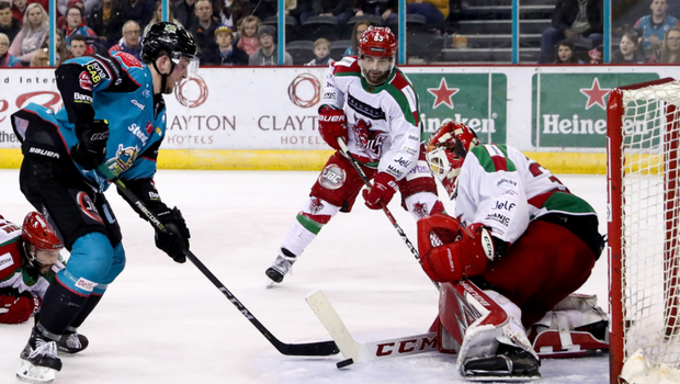 Vital strike: Curtis Leonard scores his dramatic overtime winner to hand the Giants a crucial victory over the Cardiff Devils on their way to last season's Elite League title