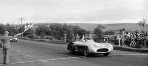 First class: Stirling Moss takes the chequered flag to win the 1955 RAC Tourist Trophy race, the last to be staged at Dundrod