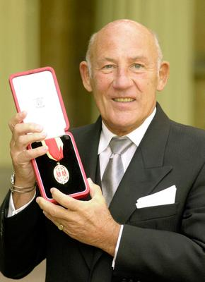 Stirling Moss receiving his knighthood in 2000