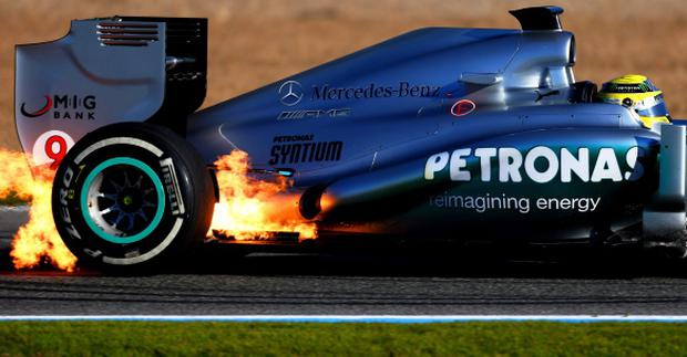 JEREZ DE LA FRONTERA, SPAIN - FEBRUARY 05: Flames erupt from the W04 belonging to Nico Rosberg of Germany and Mercedes GP during Formula One winter testing at Circuito de Jerez on February 5, 2013 in Jerez de la Frontera, Spain. (Photo by Paul Gilham/Getty Images)