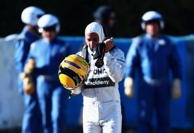 JEREZ DE LA FRONTERA, SPAIN - FEBRUARY 06: Lewis Hamilton of Great Britain and Mercedes GP walks away from his car after crashing into the gravel at turn six during Formula One winter testing at Circuito de Jerez on February 6, 2013 in Jerez de la Frontera, Spain. (Photo by Paul Gilham/Getty Images)