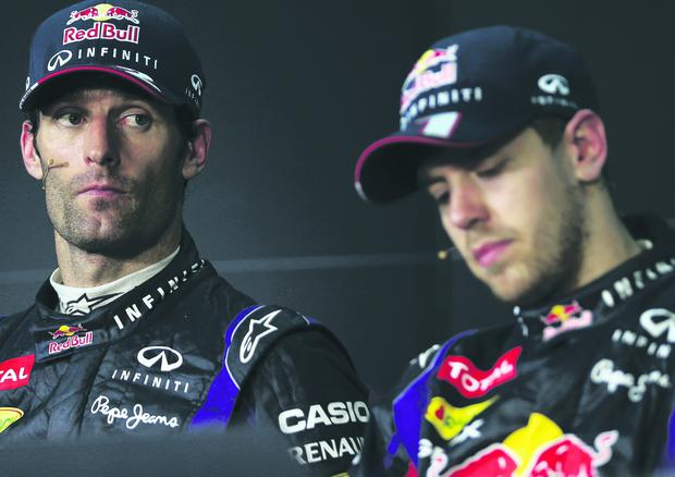 Race winner Sebastian Vettel (R) of Germany and Infiniti Red Bull Racing and second placed Mark Webber (L) of Australia and Infiniti Red Bull Racing react in the drivers press conference following the Malaysian Formula One Grand Prix at the Sepang Circuit on March 24, 2013 in Kuala Lumpur, Malaysia. (Photo by Mark Thompson/Getty Images)